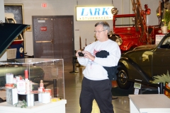 Prez Mark taking a picture of a display at the Studebaker museum