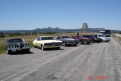 Good place for a car photo with Devils Tower in background, too bad the bus & motorhome had to get in the shot.