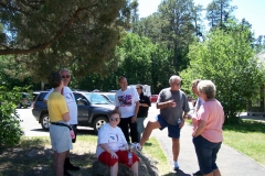 Part of the group are pausing at the Devils Tower parking lot