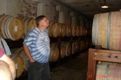A.J. Koszi checking out the wine barrels